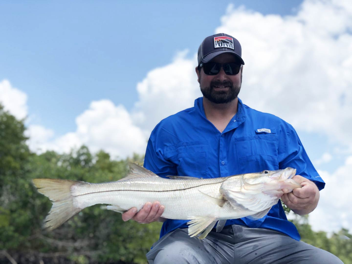 A man holding a Snook on a boat in Florida