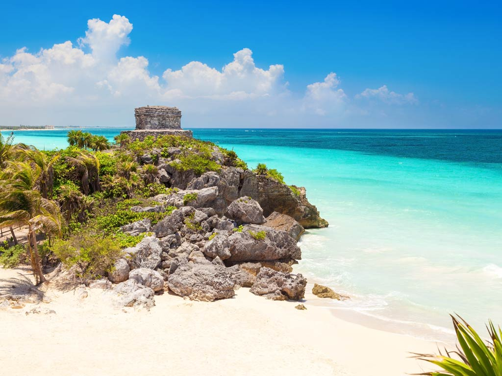 A view of a temple on a beach on the Caribbean coast of Riviera Maya