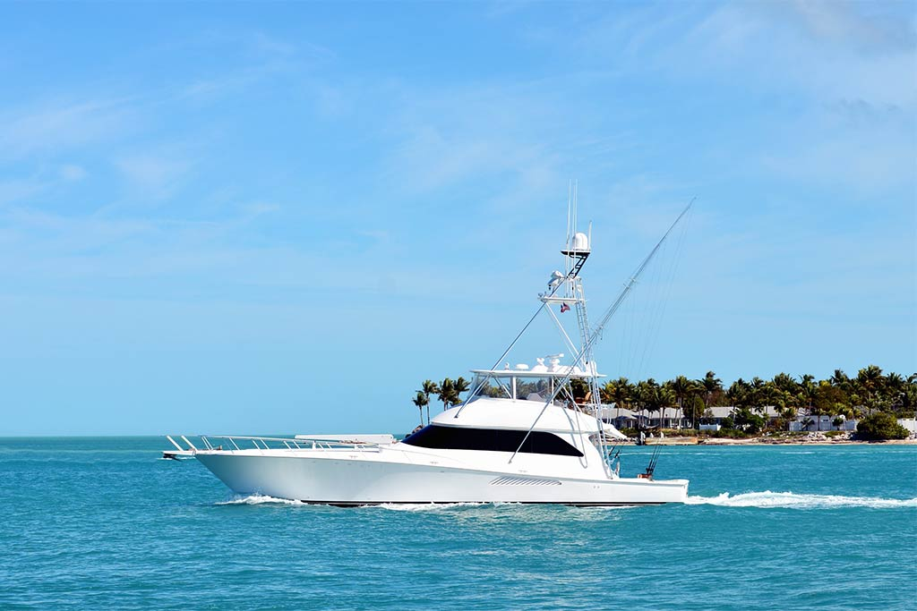 A large charter fishing boat in Key West heads out to the open waters