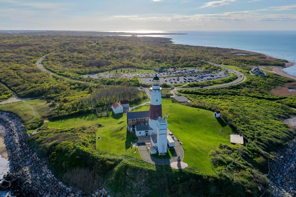 An aerial view of the Montauk Lighthouse and Beach on Long Island, New York.