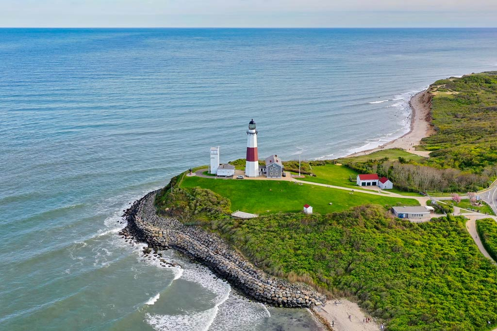 An aerial view of the Montauk Lighthouse and shoreline.