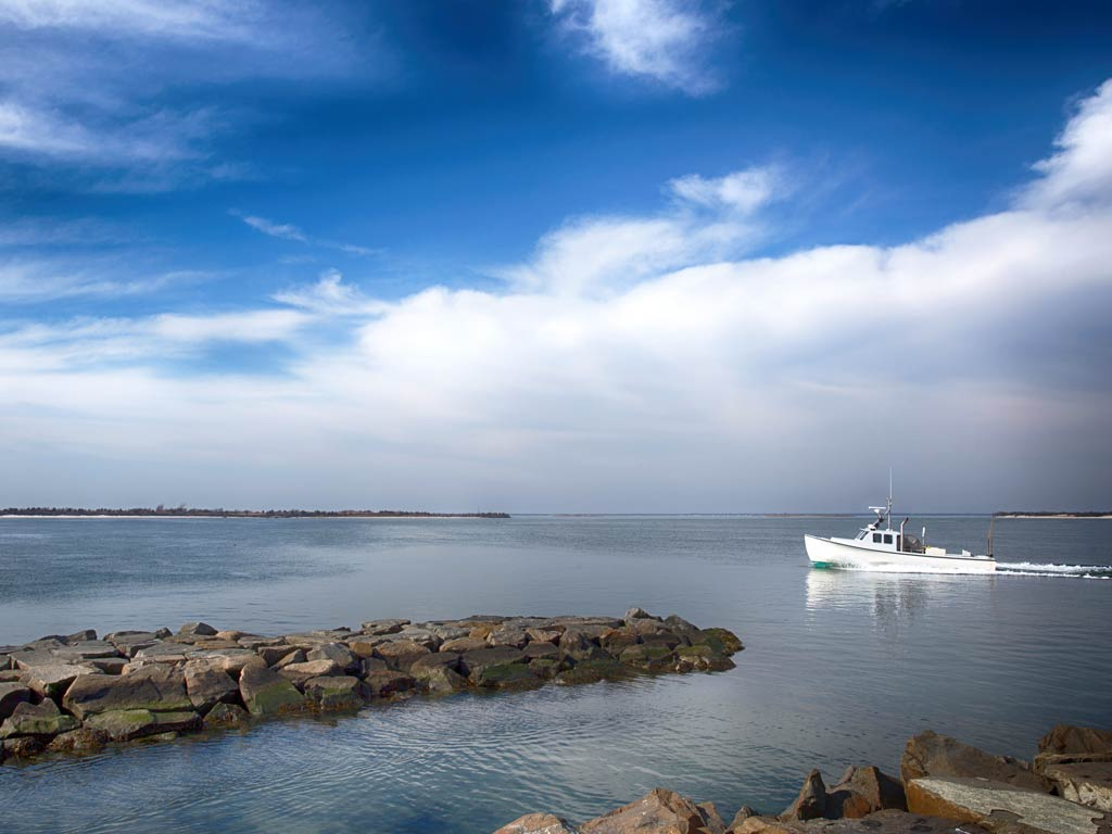 A boat on the waters of a bay in New Jersey
