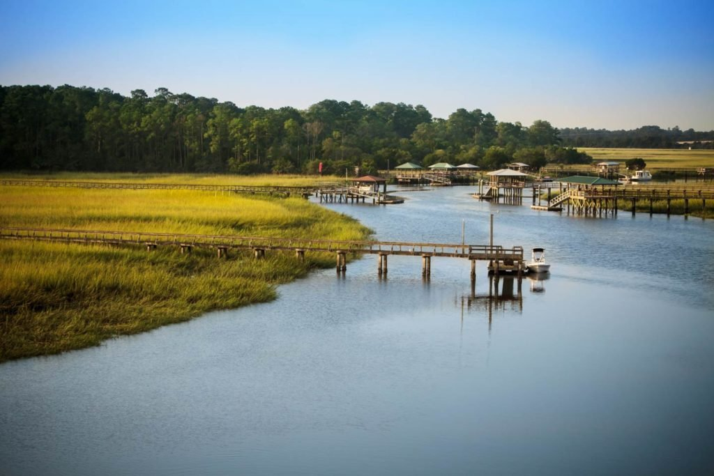 Georgia's coastal marshes with boat docks scattered across the shoreline