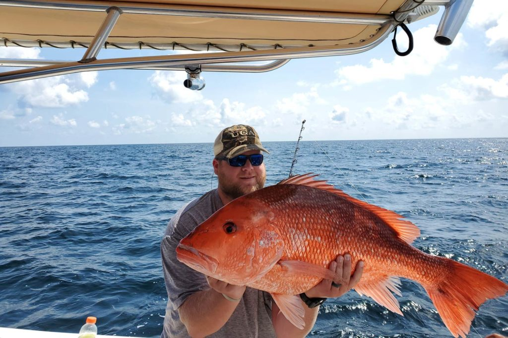 An angler holding a large Red Snapper caught in Georgia's Atlantic waters