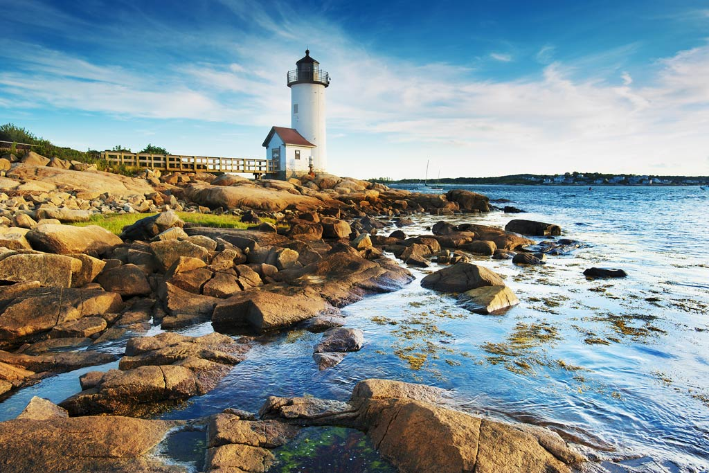 A view of a lighthouse and a beach in Massachusetts