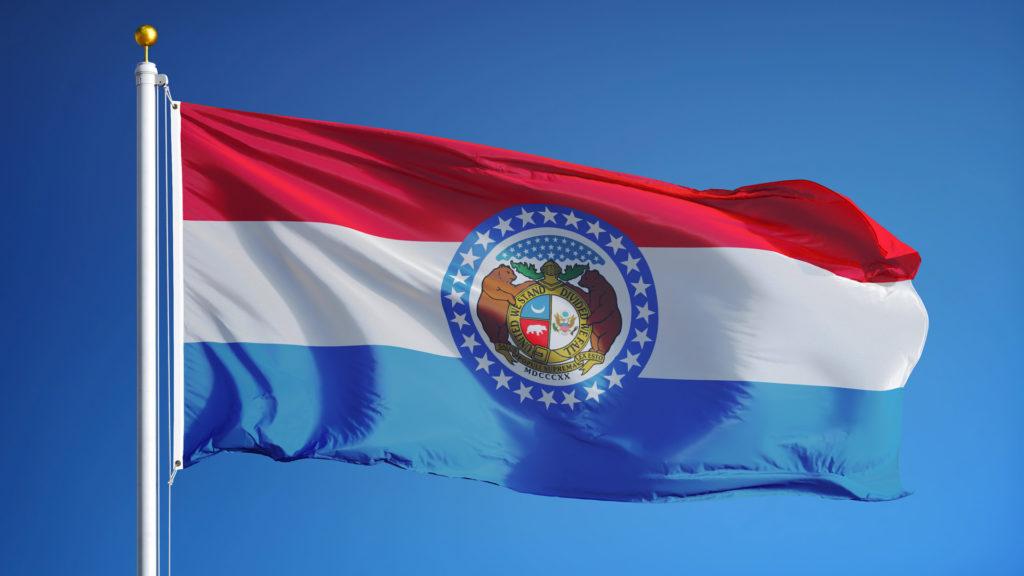 Flag of Missouri against a blue backdrop