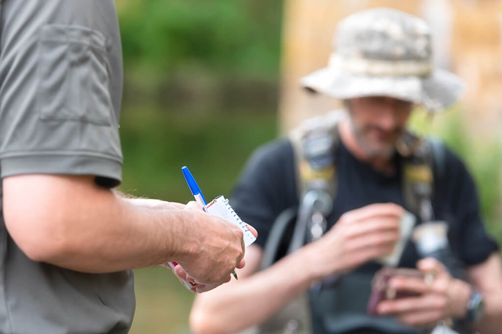 a wildlife officer checking a man's fishing license