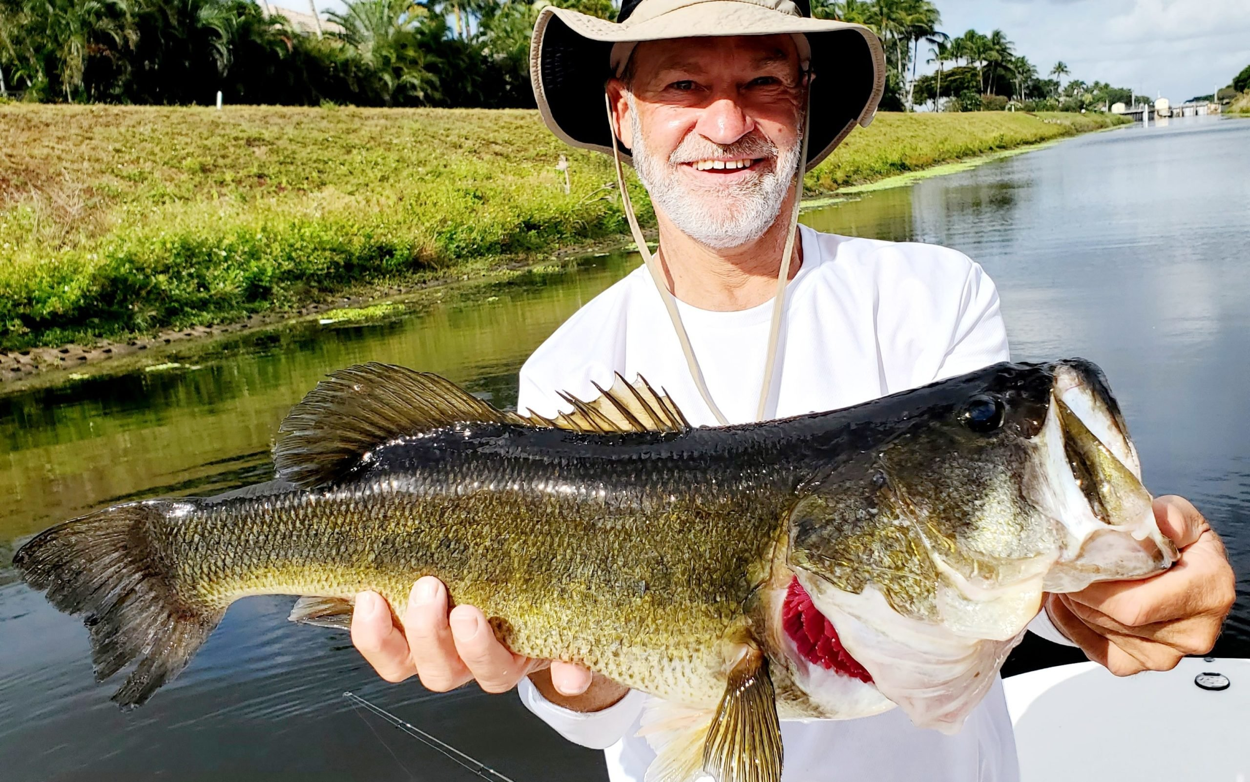 Happy angler in Florida with his freshly-caught Bass