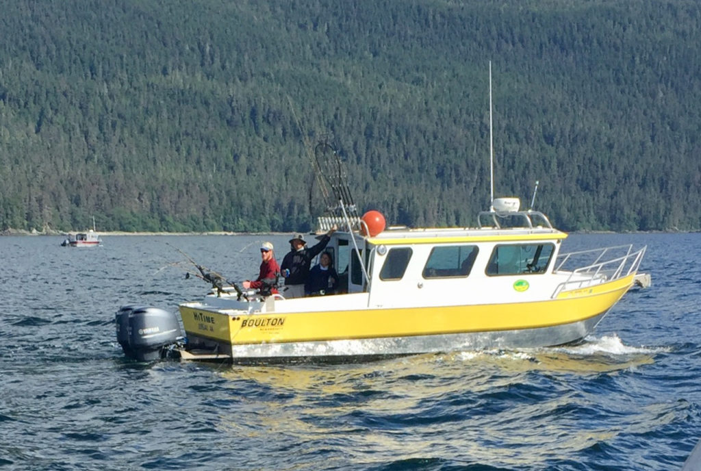 An Alaskan charter fishing boat with anglers on board