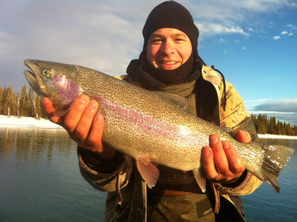 A winter angler holding a Rainbow Trout