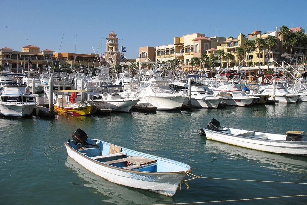 Cabo San Lucas harbor with the town in the background and boats in the foreground