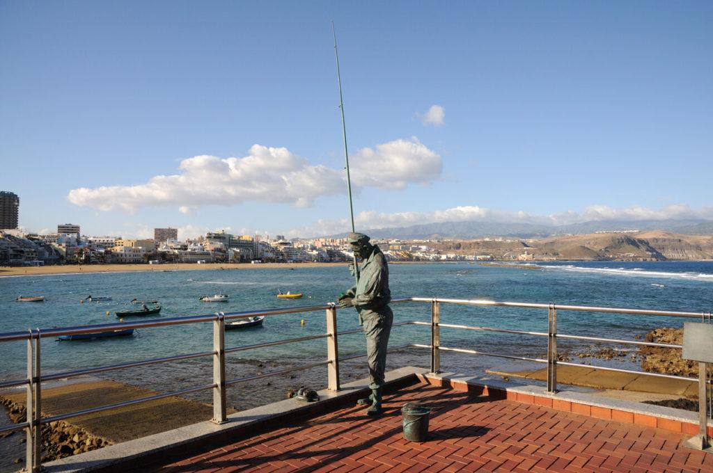 A statue of a fisher on the shore of Las Palmas de Gran Canaria.