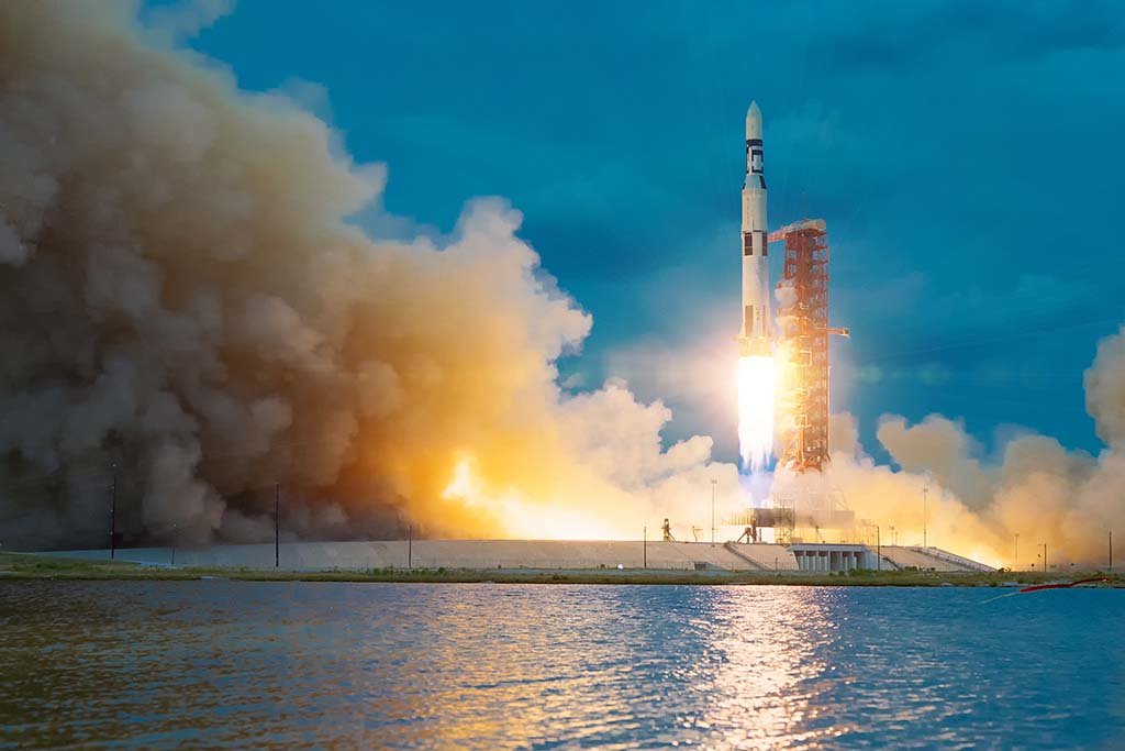 A rocket launches into air along Cape Canaveral's waterfront