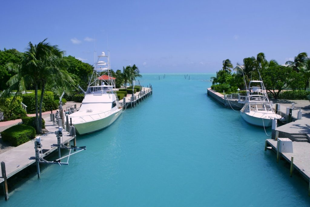 Florida Keys fishing boats in a marina with the open sea in the background