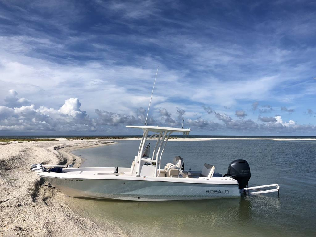 A center console boat parked at a beach in Florida.