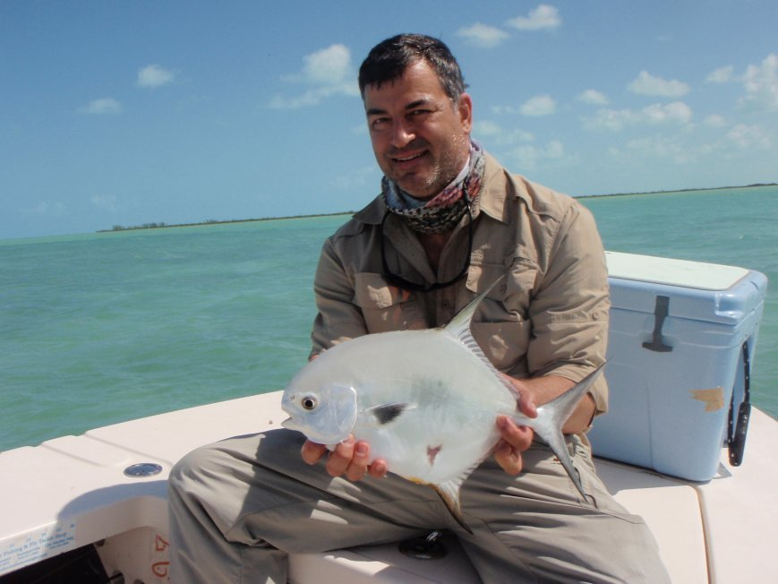 An angler holding a Permit