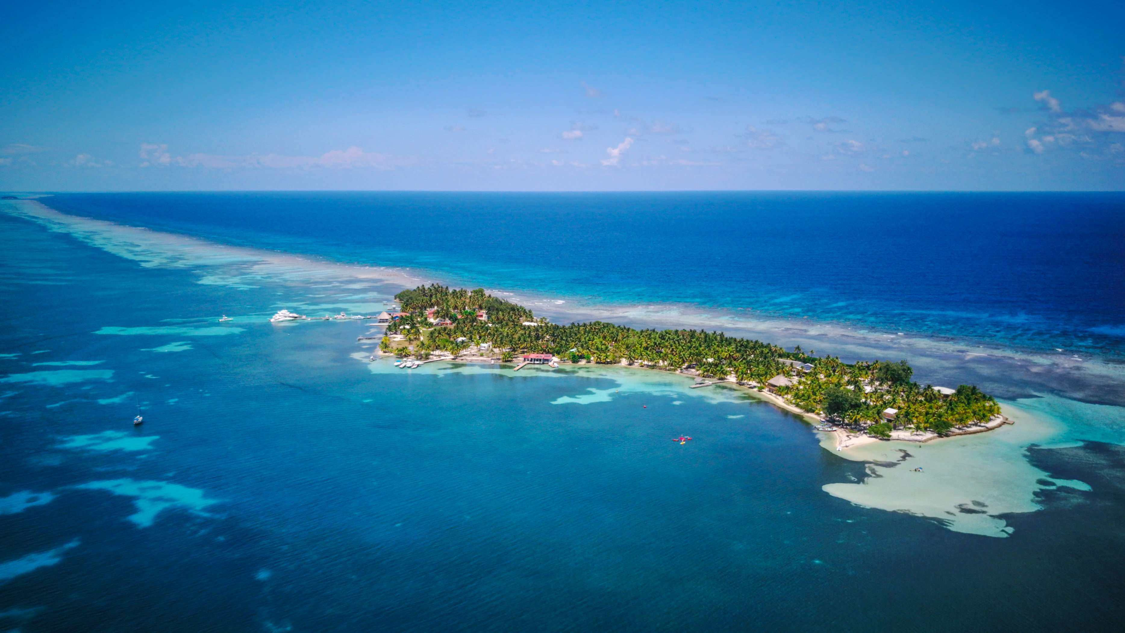aerial photo of tropical island South Water Caye in Belize