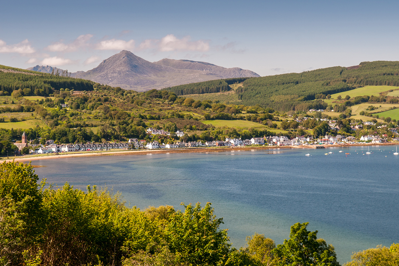 A sheltered bay on the Isle of Arran, with mountains in the distance