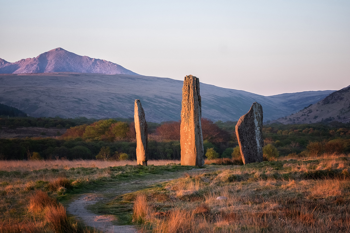 Ancient standing stones on the Isle of Arran, with Goat Fell mountain in the distance