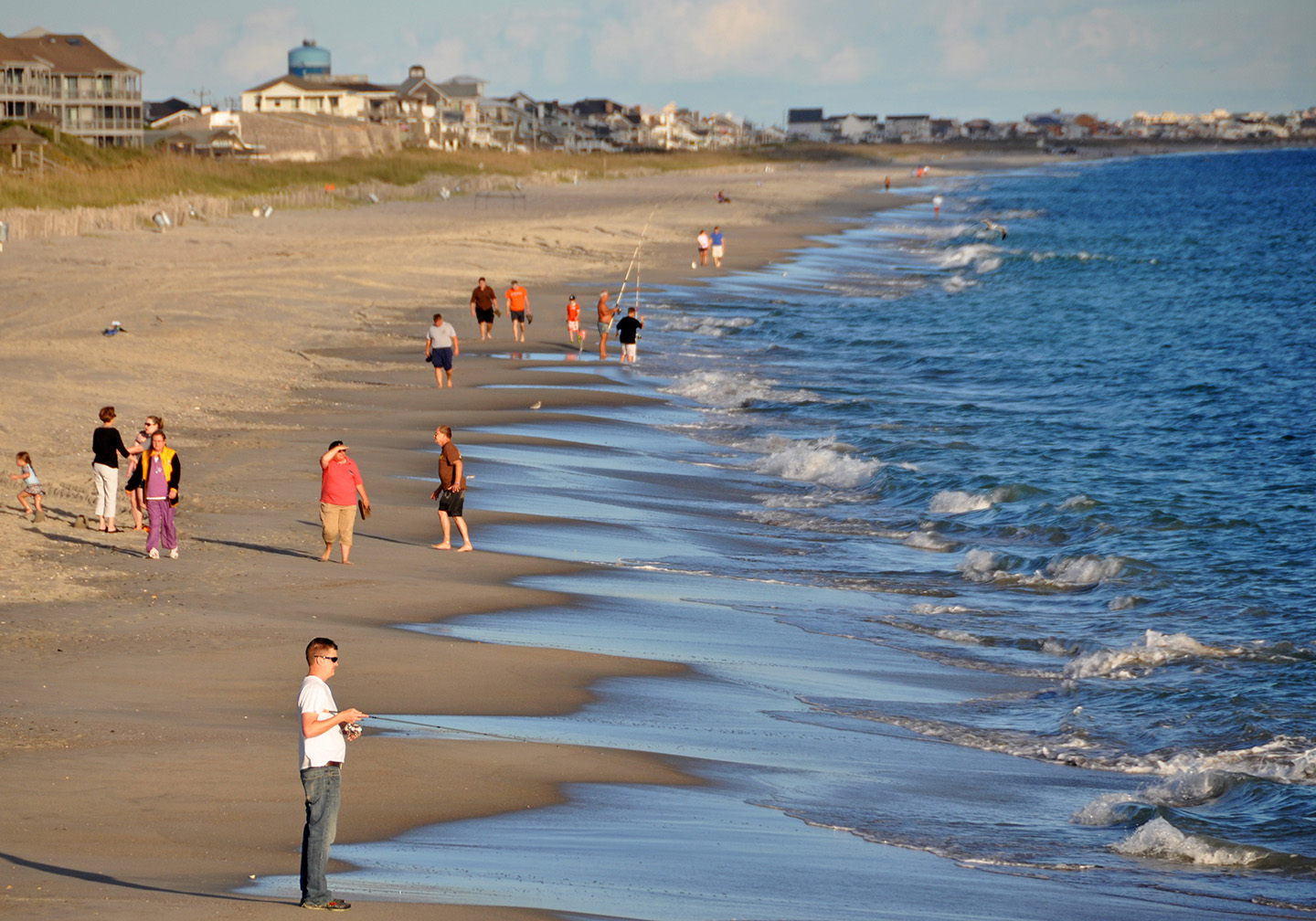 People relaxing and fishing on a beach in Atlantic Beach, NC