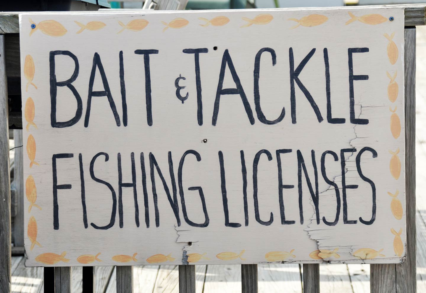A sign advertising a bait and tackle shop, a common place to buy a LA fishing license