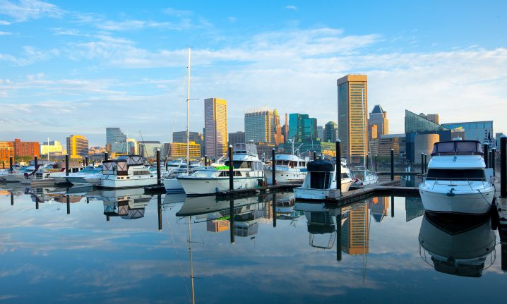 Baltimore Marina with boats in the center and tower blocks in the distance