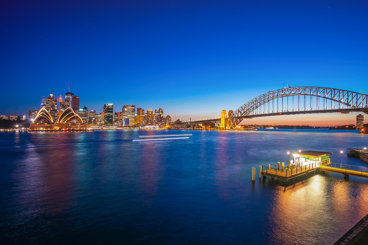 Beulah Street Wharf at night, with the Sydney Opera House and Harbour Bridge in the distance