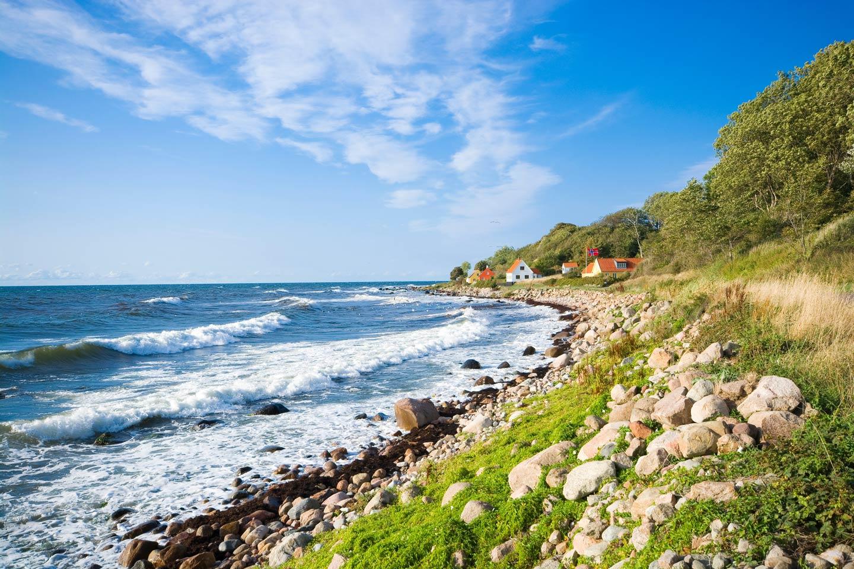 A fishing hamlet on the rocky shores of Bornholm Island in Denmark's Baltic Sea.