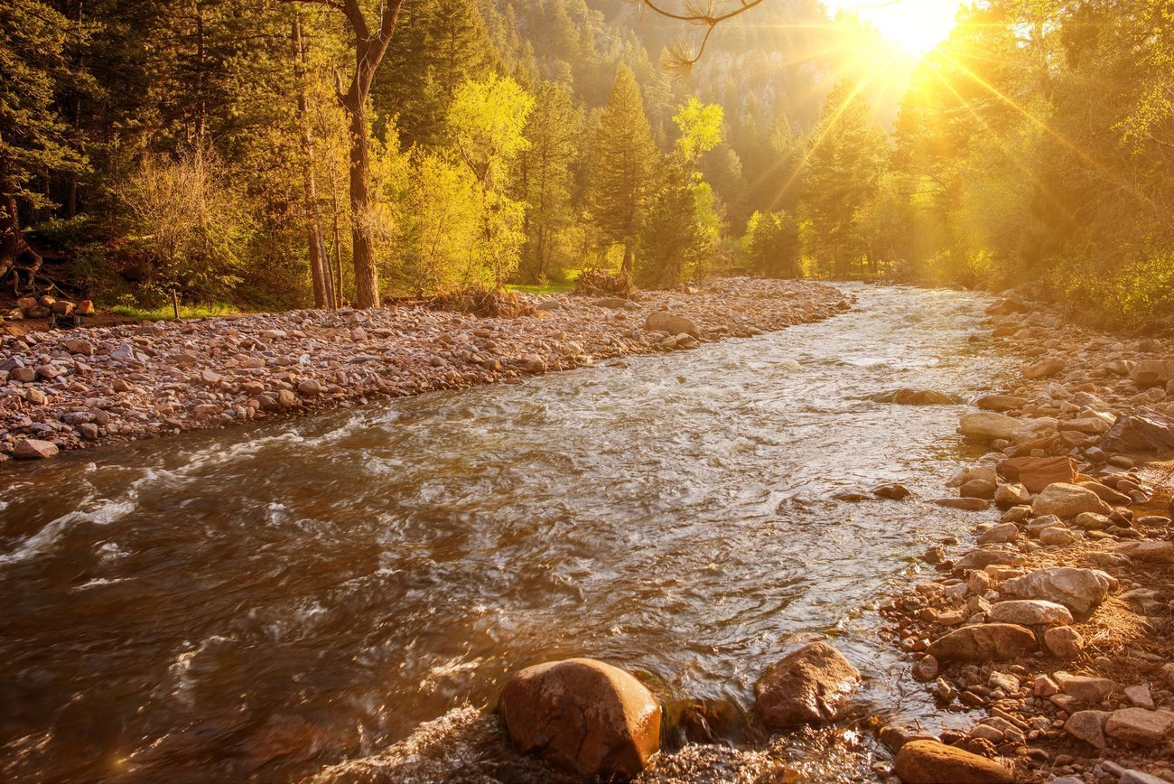 Sunset over the river creek in Colorado