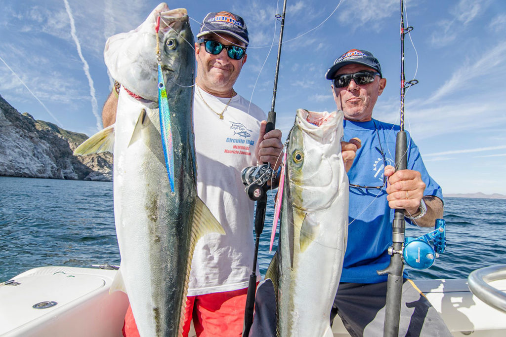 Two anglers holding large Yellowtail Amberjacks caught off the coast of Catalina Island.