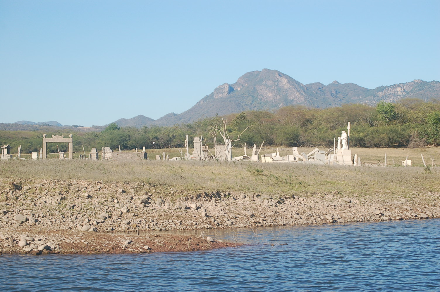 A view from the water of the flooded cemetery in Sinaloa Mexico