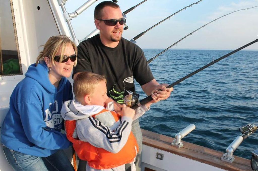 A family charter fishing on Lake Michigan