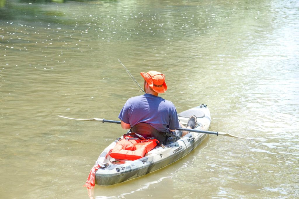 An angler on a kayak looks for his prey on one of the rivers leading to the Chesapeake Bay