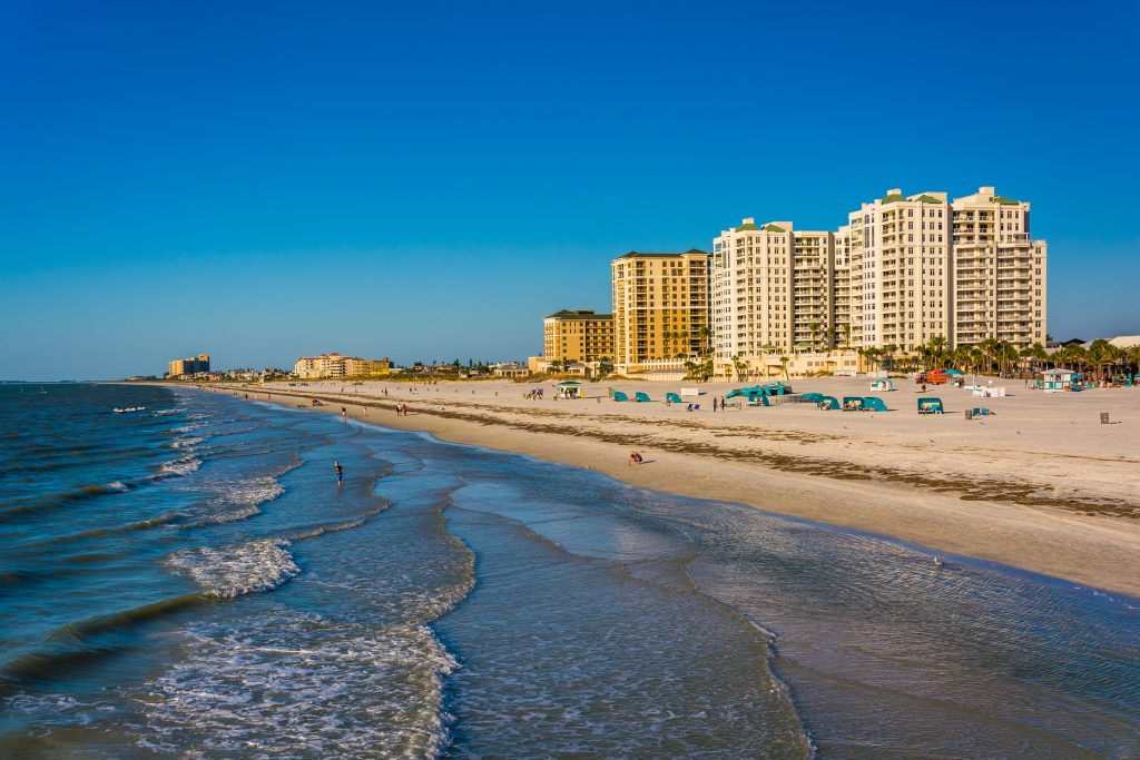 A view along the shoreline at Clearwater Beach, FL, with hotels in the distance