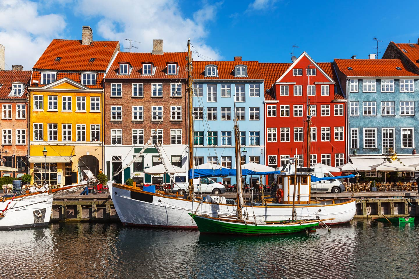 Boats parked in front of Copenhagen's landmark colorful homes in the Nyhavn area.