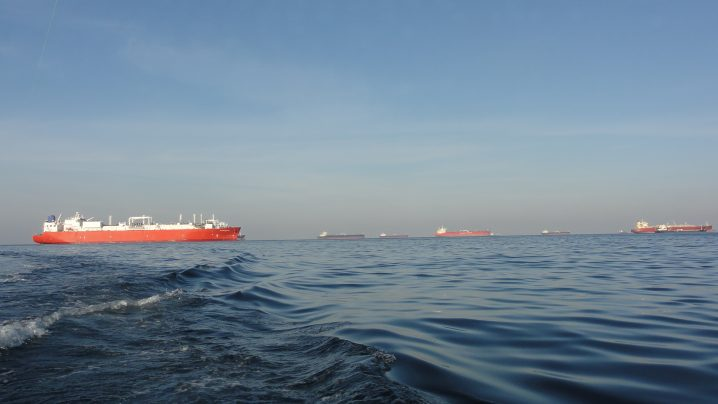 Red and white oil tanker anchored off Fujairah