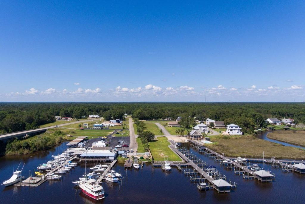 A view of one of Dauphin Island's marinas on a sunny day, with charter vessels docked