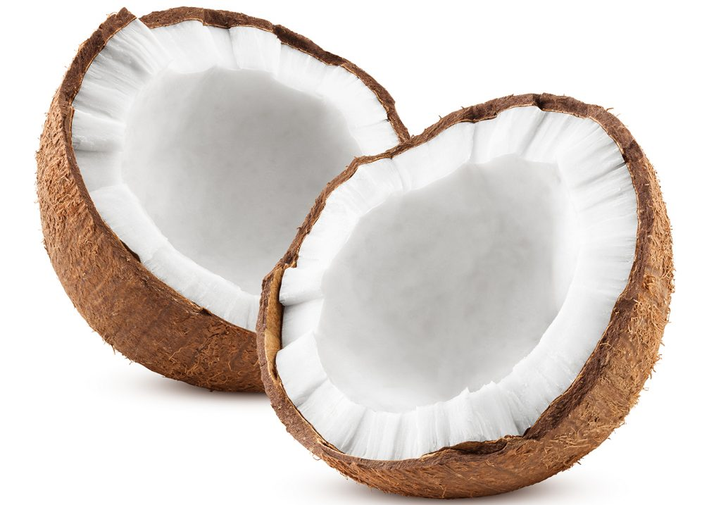 Two halves of a coconut on a white background