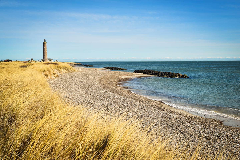 A view of a lighthouse on the Danish coastal of the Jutland Peninsula.