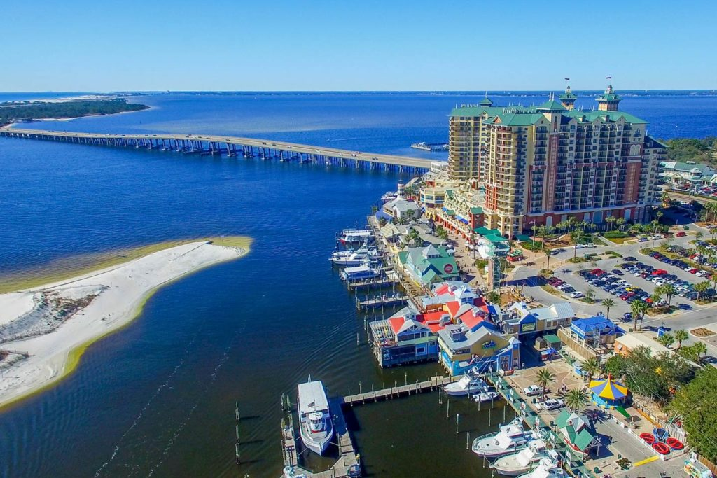 An aerial view of Destin, FL's cityscape, showing the Gulf to the left