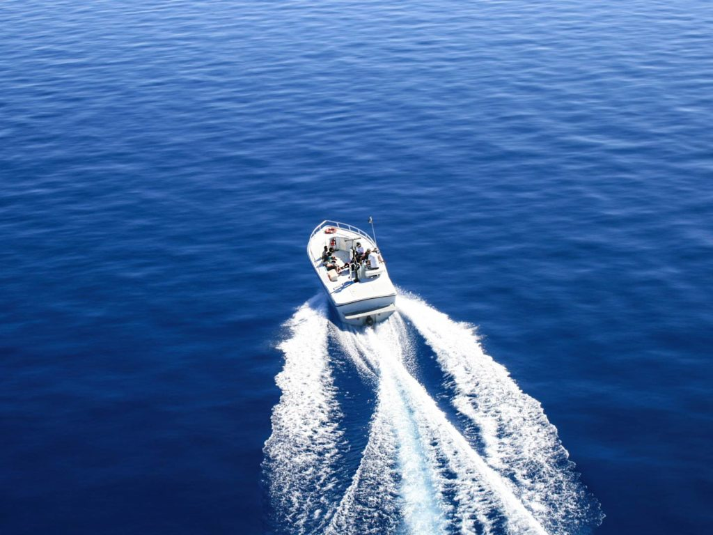 A motor boat on a lake