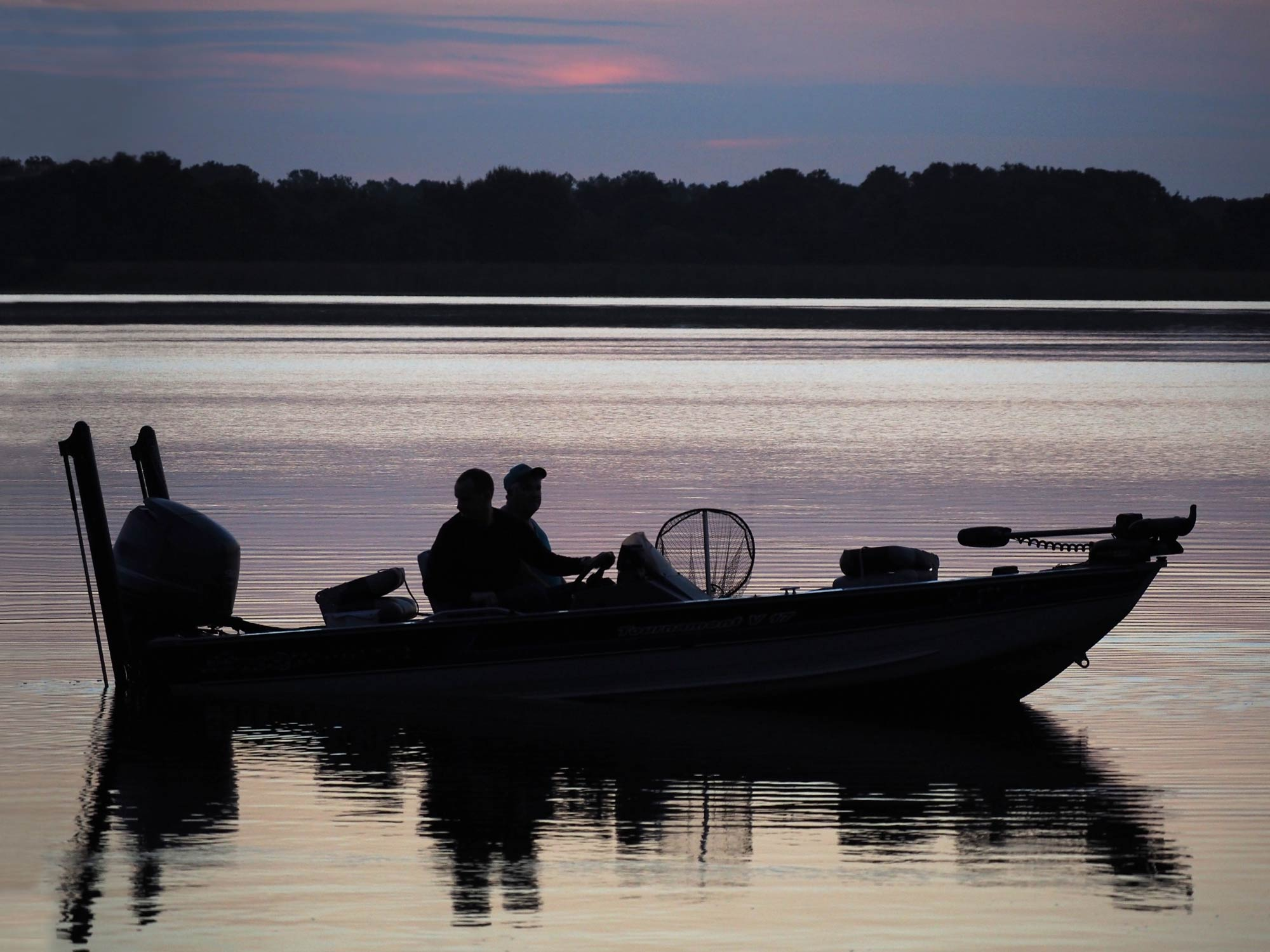 A pair of anglers on the water before the sunrise