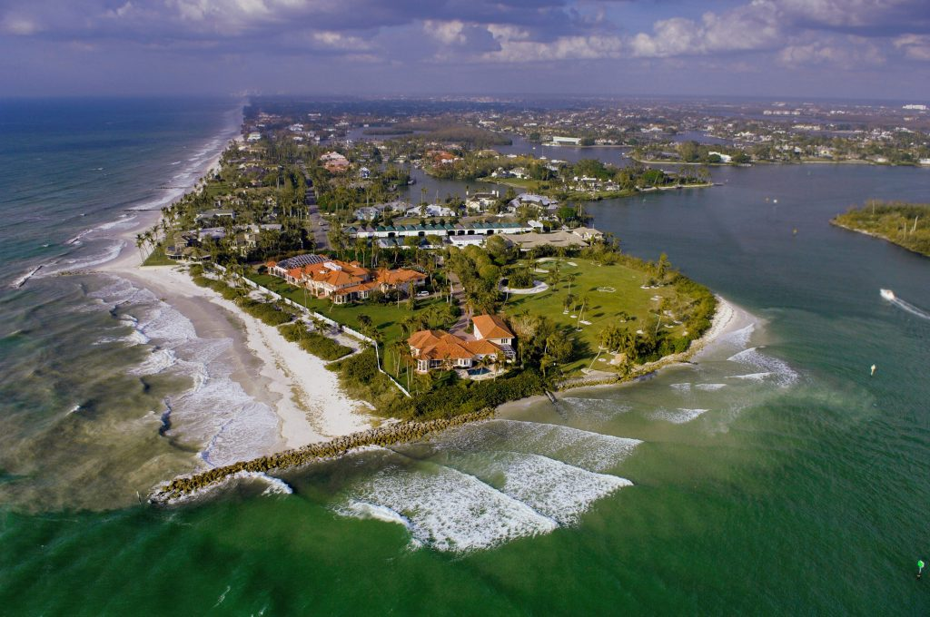 An aerial view of Naples, Florida, looking from Gordon's Pass towards the city, with the sea on the left.