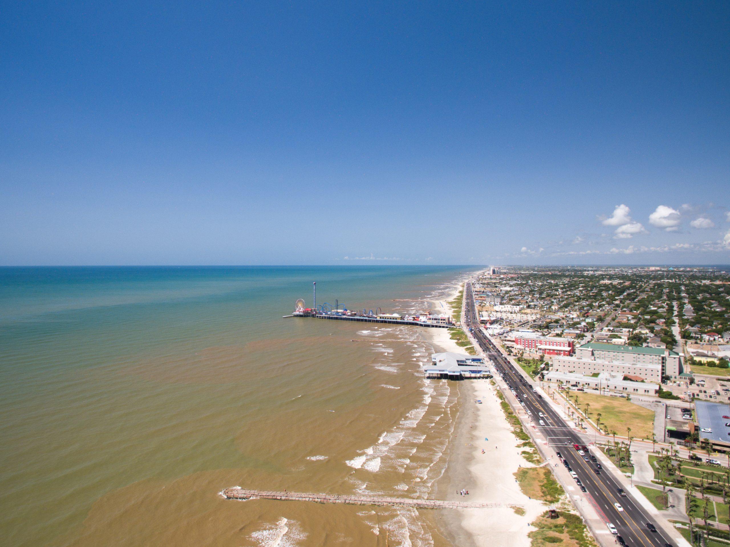an aerial view of Seawall Boulevard in Galveston