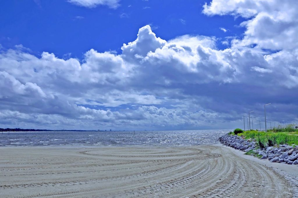 A serene beach located in Gulfport, MS on a sunny day