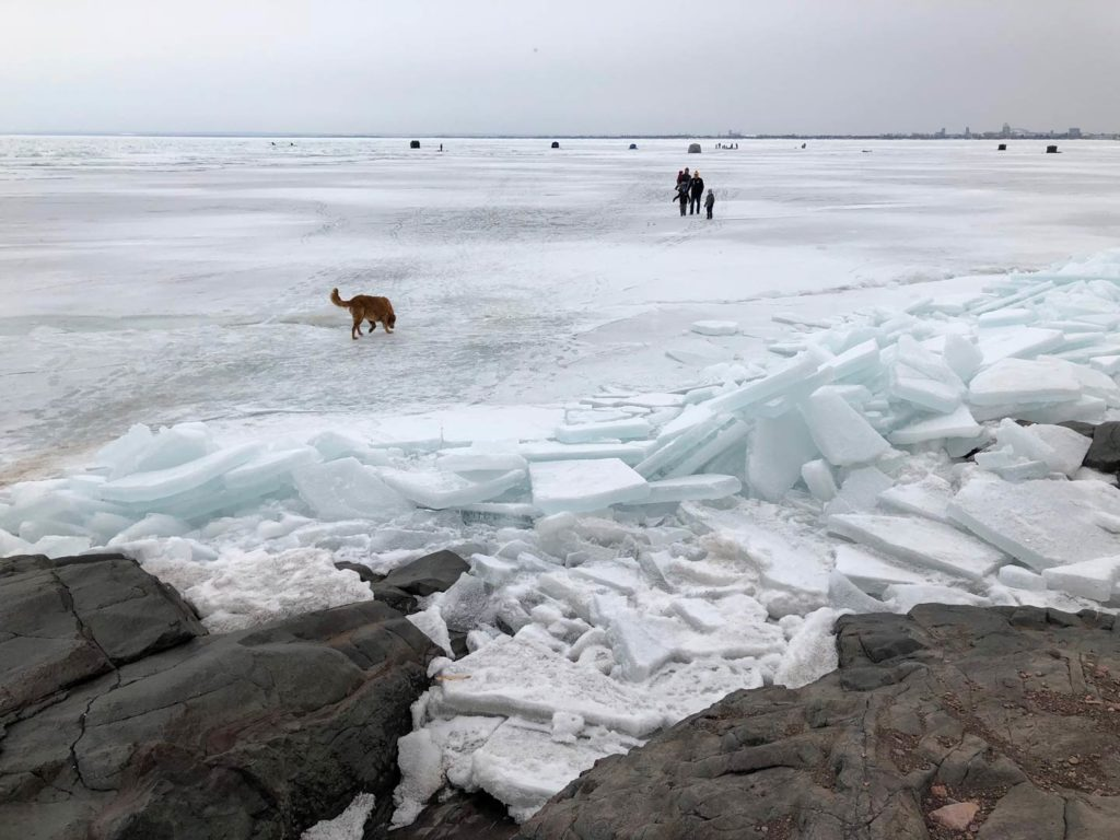 A family returning from ice fishing in Duluth Minnesota