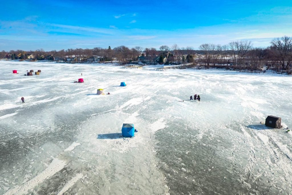 An aerial view of ice fishing on Lake Michigan