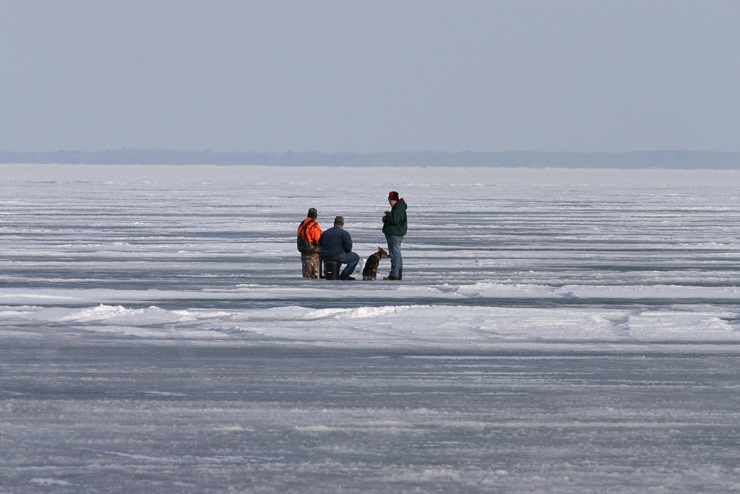 three anglers fishing on ice in Michigan