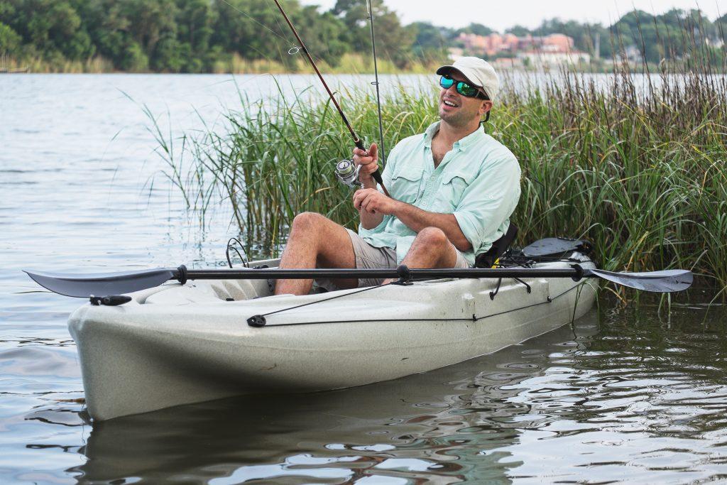 Kayak angler sitting in his kayak, fishing