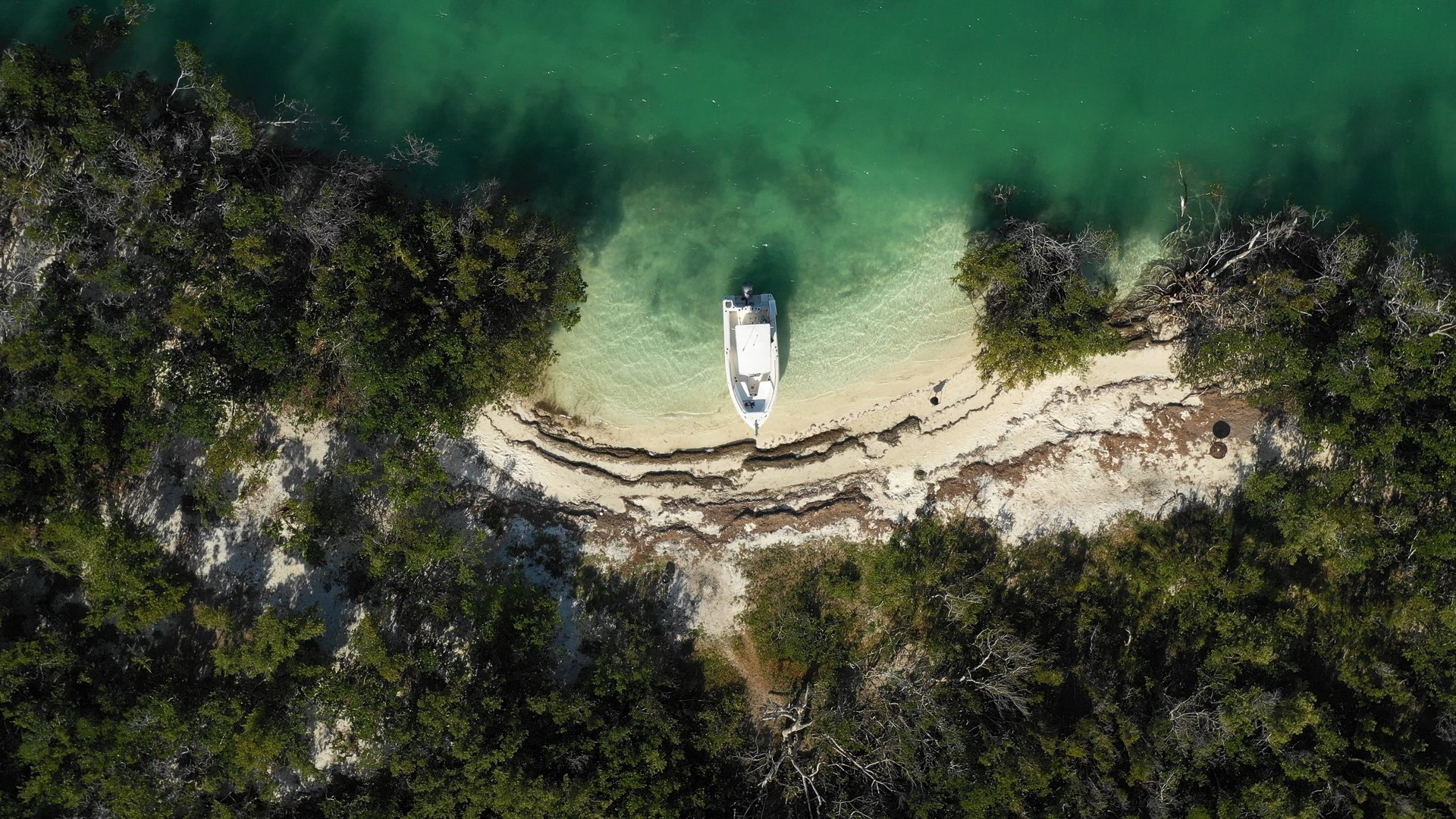 An aerial view of a fishing boat in a small bay in the Florida Keys